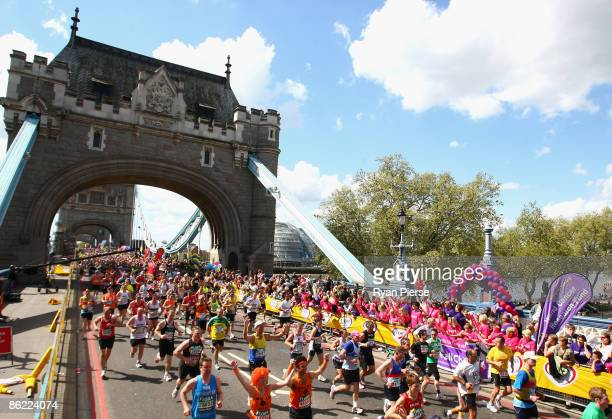 Runners cross Tower Bridge during the 2009 Flora London Marathon on April 26 2009 in London England