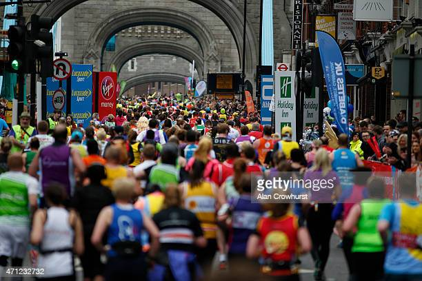Runners cross Tower Bridge during the Virgin Money London Marathon on April 26 2015 in London England