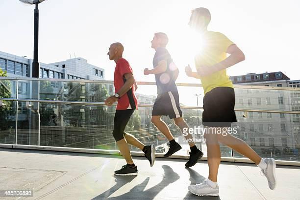 Runners crossing bridge, Munich, Germany