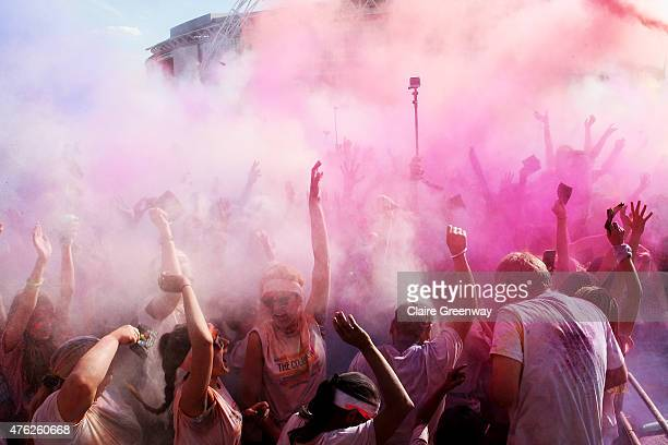 Runners dance during a Color Throw at the finish festival at The Color Run at London's Wembley Park on June 7 2015 in Wembley England The 19000...