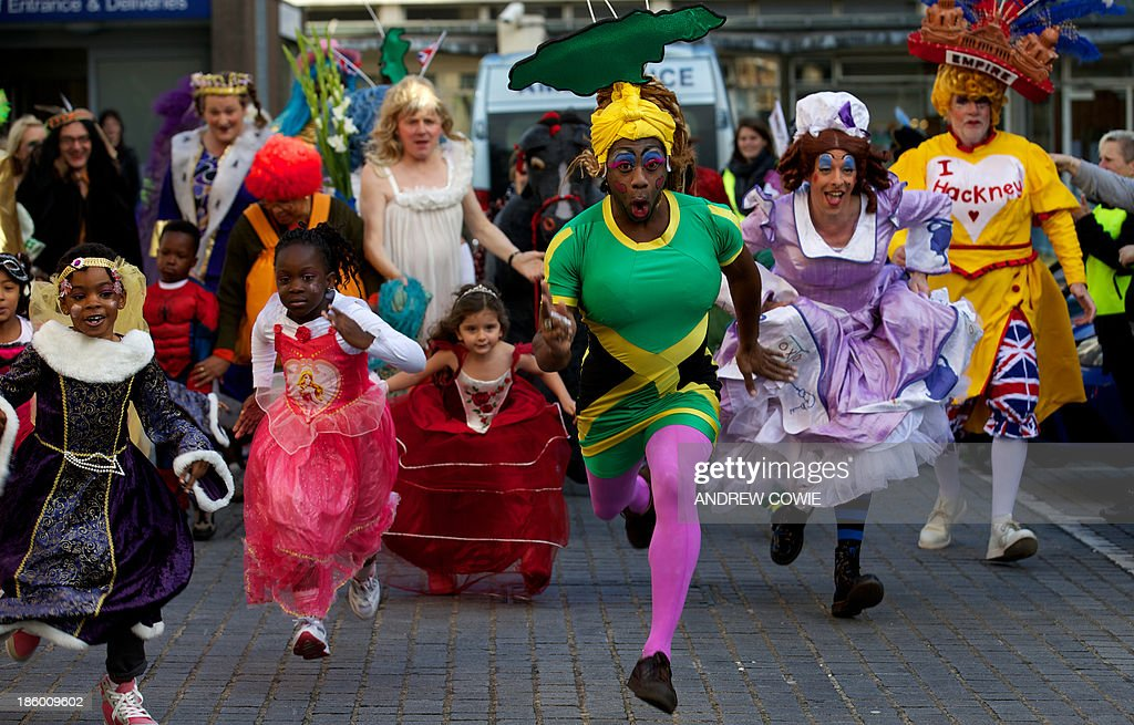 Runners dressed as Dames compete in the 1km Dame Dash charity run, a fundraiser in aid of Hackney Empire and St Joseph's Hospice in London on October 27, 2013.