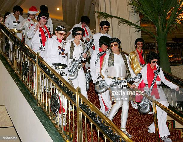 Runners dressed as Elvis Presley walk through the Mandalay Bay Resort Casino as they make their way to the starting line for the inaugural running of...