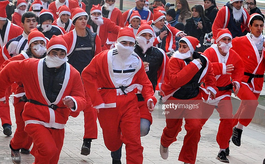 Runners dressed as Father Christmas participate in a 'Santa Run' fun run in the Armenian capital Yerevan, on December 28, 2012. AFP PHOTO / KAREN MINASYAN