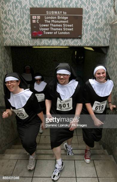 Runners dressed as nuns exit a subway at London Bridge as they take part in a charity 'Nun Run' to raise money for Barnardo's