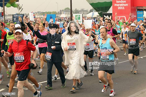 Runners dressed as Prince William and Kate Middleton depart Blackheath at the start of the 2011 Virgin Money London Marathon on April 17 2011 in...