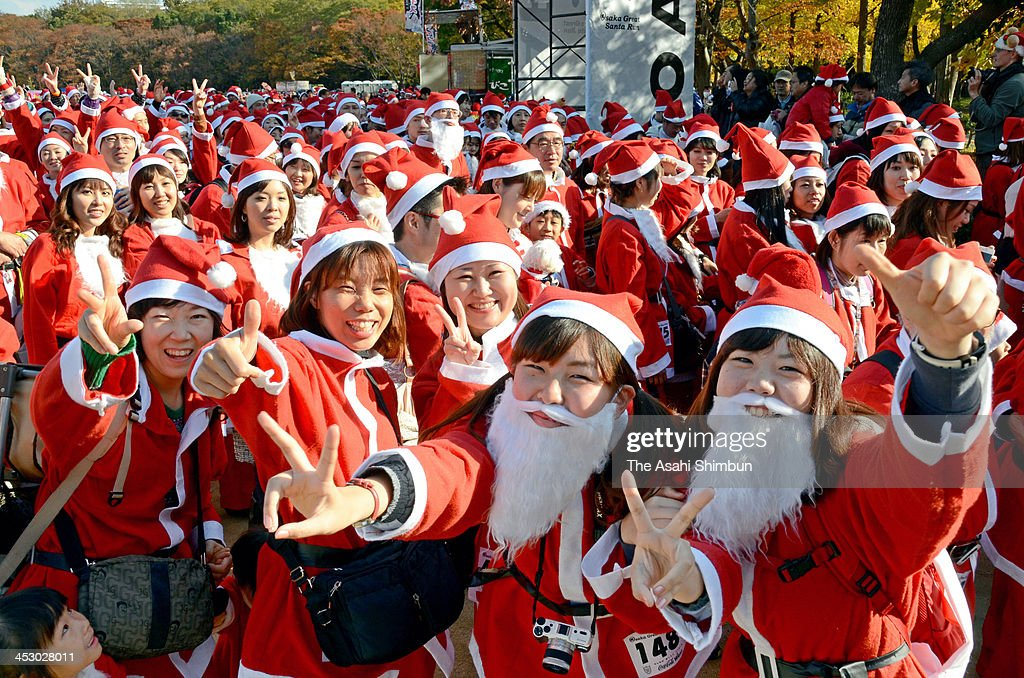 Runners dressed as Santa Claus participate in the 5th annual Osaka Great Santas run at fornt of the Osaka Castle on December 1, 2013 in Osaka, Japan. Participation fees will be donated to children who have to spend Christmas day in a hospital.