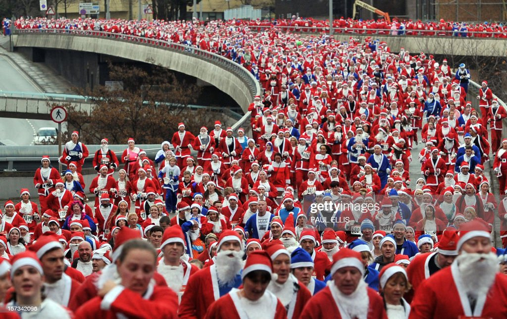 Runners dressed in Father Christmas costumes take part in the annual five kilometer Santa Dash in Liverpool, north-west England, on December 2, 2012. Many runners wear a blue suit, usually supporters of Everton FC, who refuse to run in the colours of their city rivals Liverpool FC.