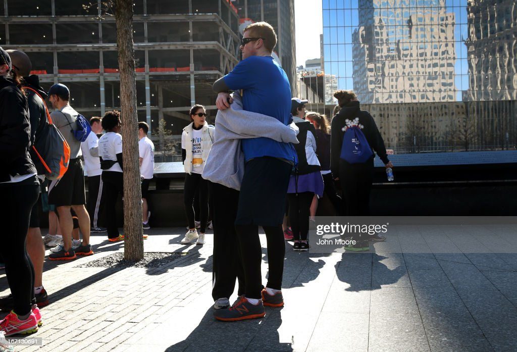 Runners embrace following the 9/11 Memorial 5K Run/Walk on April 21, 2013 in New York City. Security was tight for the race, as has been the case in large scale events around the country since the Boston Marathon bombings. April 21 marks the anniversary that President Barack Obama signed into law legislation making 9/11 a day of service and volunteerism in memory of the victims of the 2001 attacks.