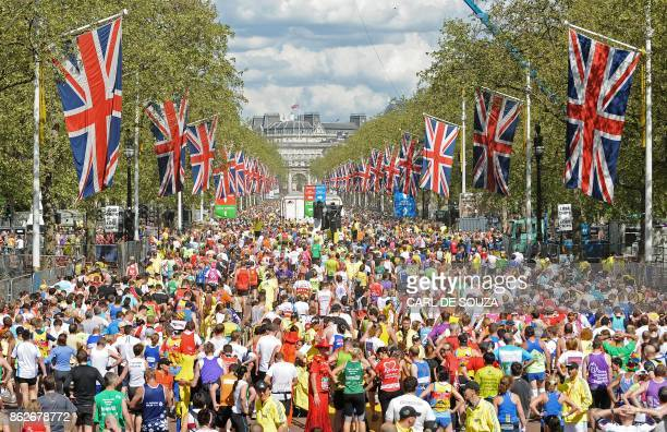 Runners fill the road after crossing the finish Line near Buckingham Palace during the 2009 London Marathon April 26 2008 in London AFP PHOTO/Carl de...