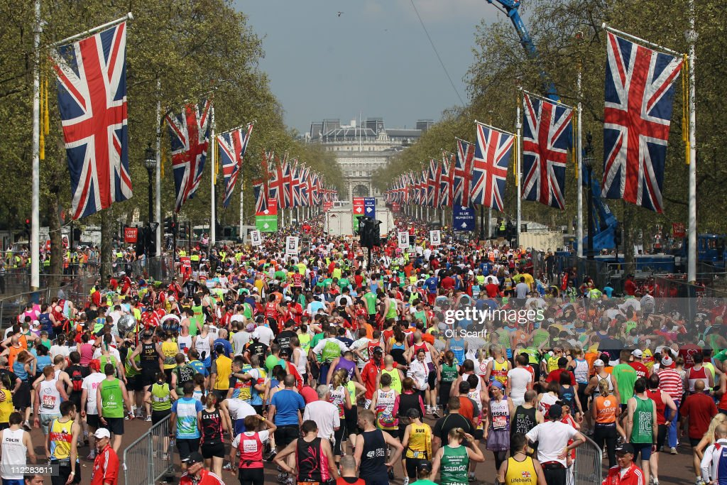 Runners finish the 2011 Virgin Money London Marathon on the Mall on April 17, 2011 in London, England. 36,500 competitors will tackle the 26.2 mile course which passes several iconic London landmarks and finishes on the Mall in front of Buckingham Palace.