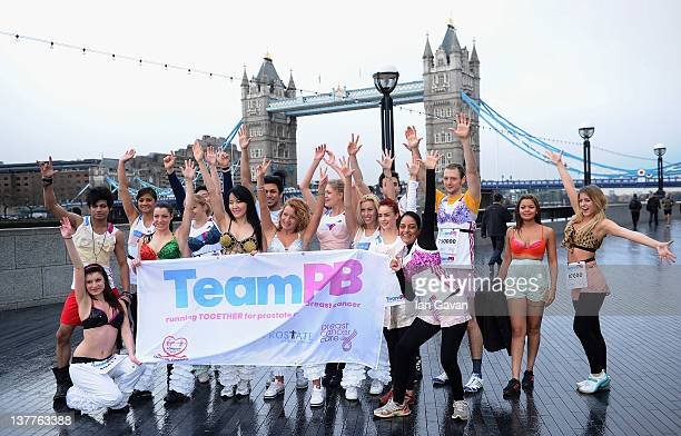Runners for a photograph during the Team Pants And Bra photcall at Tower Bridge on January 26 2012 in London England Team Pants and Bra sprinted...
