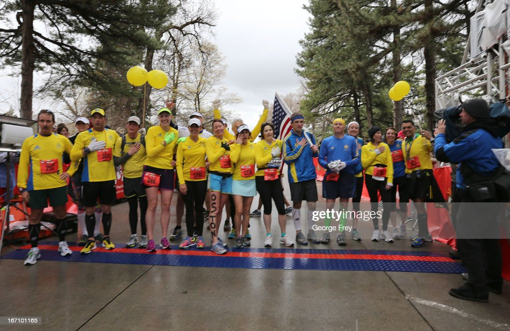 09 group pose for a picture at the finish line at the Salt Lake City Marathon on April 20, 2013 in Salt Lake City, Utah. The group wanted to cross the finish line at the same time the bombs went off at the Boston Marathon in honor of those that were killed, injured, or not able to finish the race. Due to the bombings at the Boston Marathon on April 15, security was dramatically increased by law enforcement and Utah National Guard at the Salt Lake City Marathon. Organizers are asking spectators to leave backpacks at home.