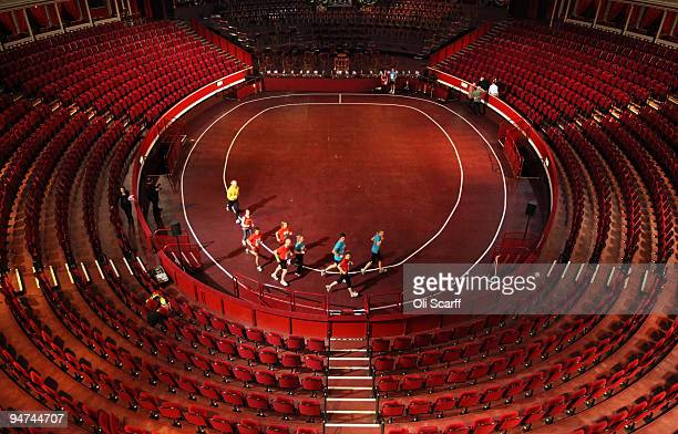 Runners from the Royal Albert Hall and the Royal Philharmonic Orchestra mark the 100 year anniversary of the first indoor marathon held in England by...