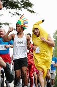 Runners having water in marathon
