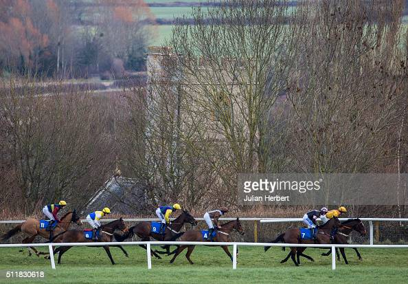 Runners head down the back straight during The MercedesBenz Of Taunton Handicap Hurdle Race run at Taunton Racecourse on February 23 2016 in Taunton...