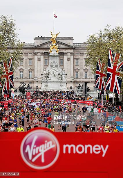 Runners head down the Mall towards the finish line during the Virgin Money London Marathon on April 26 2015 in London England