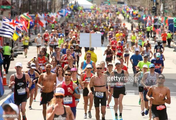 Runners head for the finish line of the 121st Boston Marathon on Boylston Street in Boston on April 17 2017