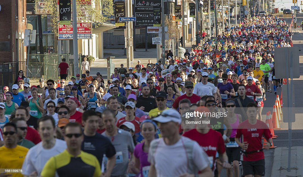 Runners head south on Yonge St. moments after the start of the Toronto Marathon from Mel Lastman Square, North York.