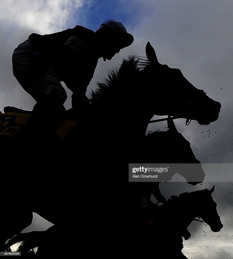 Runners in silhouette at Punchestown racecourse on May 01, 2014 in Naas, Ireland.