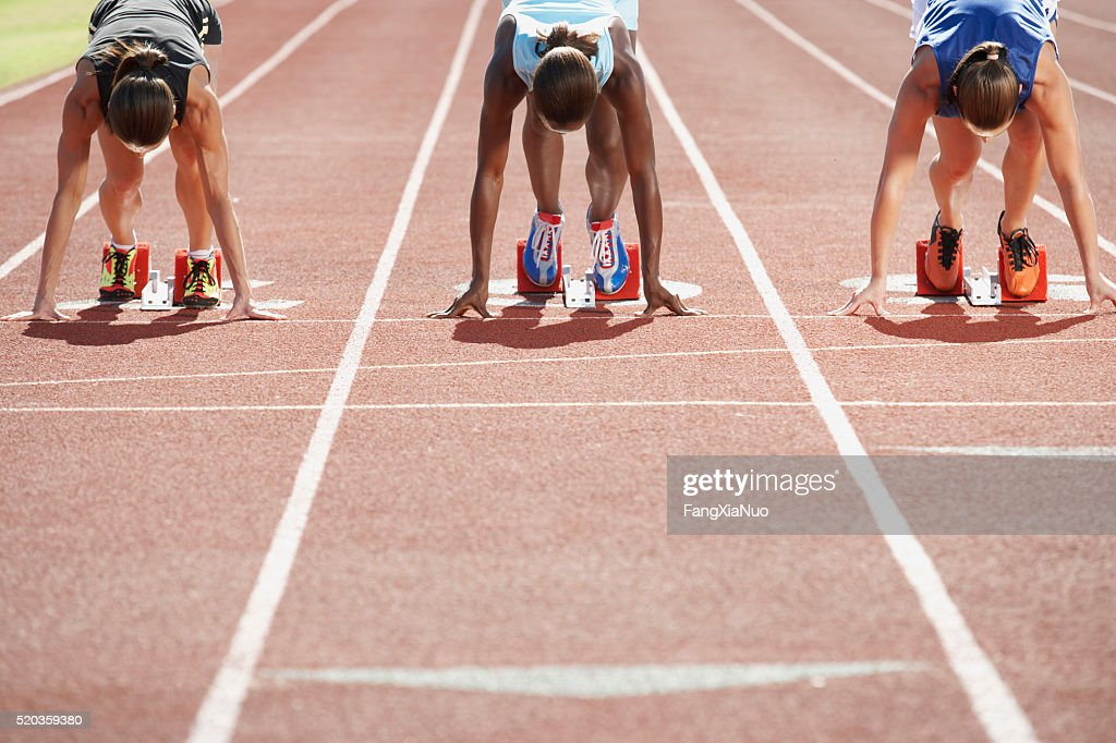 Runners in starting blocks : Stock Photo