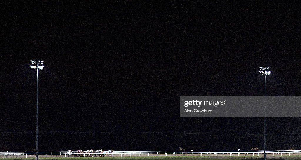 Runners in The 32Red Casino Handicap Stakes race down the back straight at Kempton racecourse on November 22, 2012 in Sunbury, England.