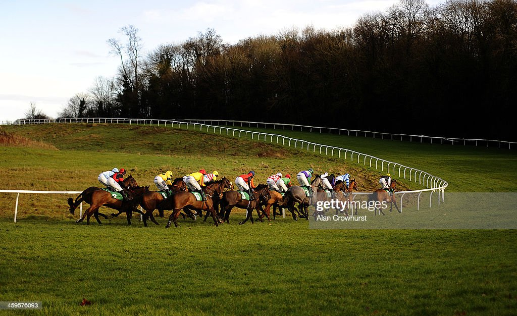 Runners in The Download The Coral Mobile App Maiden Hurdle Race take bottom bend at Chepstow racecourse on December 28, 2013 in Chepstow, Wales.
