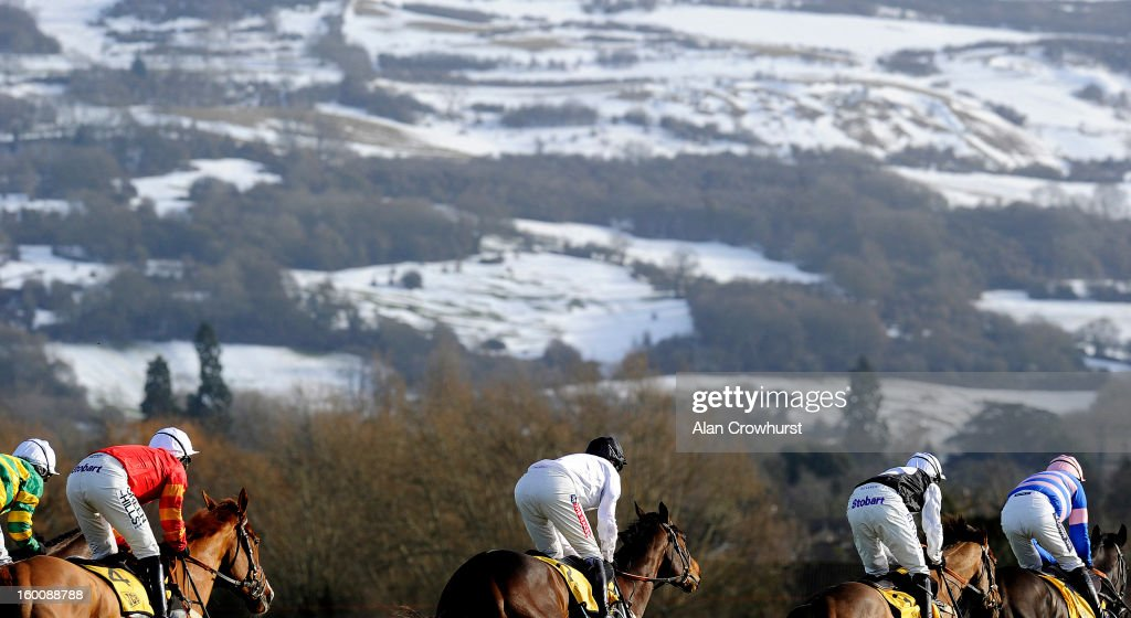 Runners in The JCB Triumph Hurdle Trial take the top bend towards the snow covered Cleeve Hill at Cheltenham racecourse on January 26, 2013 in Cheltenham, England.
