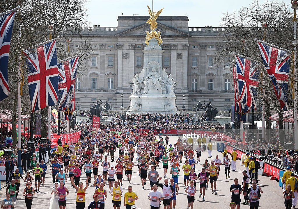 Runners in the London Marathon pass Buckingham Palace as they enter the finishing straight on April 21, 2013 in London, England. Thousands of runners are taking part - with some wearing black ribbons as a mark of respect to the Boston victims. Extra police are on duty as an estimated 500,000 people line the streets of the capital.