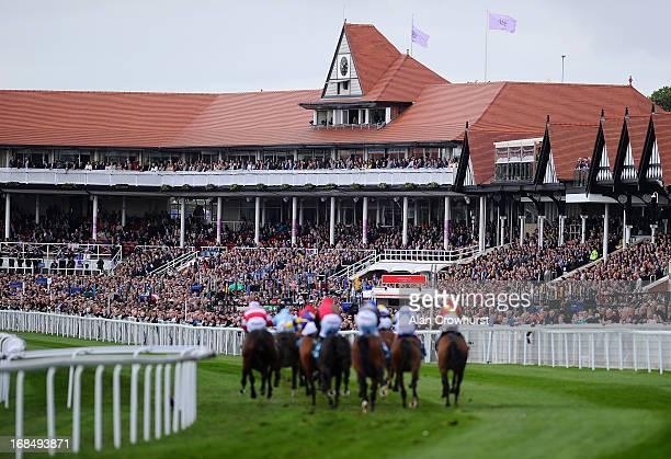 Runners in The sportingbetcom Earl Grosvenor Handicap Stakes turn into the straight and race toward the finish at Chester racecourse on May 10 2013...