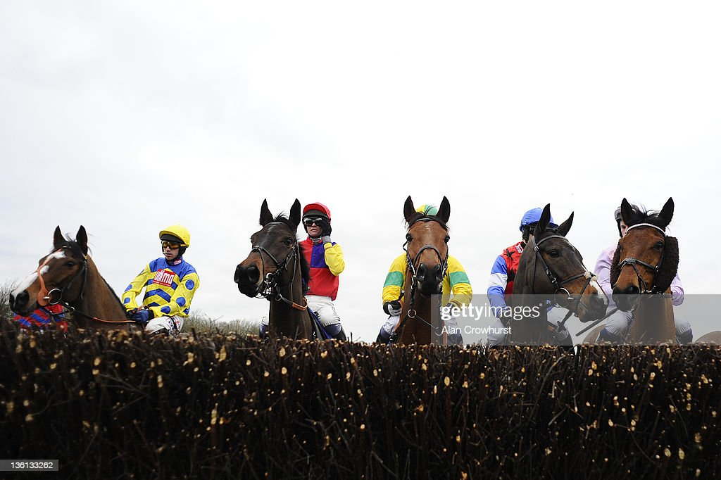 Runners inspect the first fence in The Coral Welsh National at Chepstow racecourse on December 27, 2011 in Chepstow, Wales.