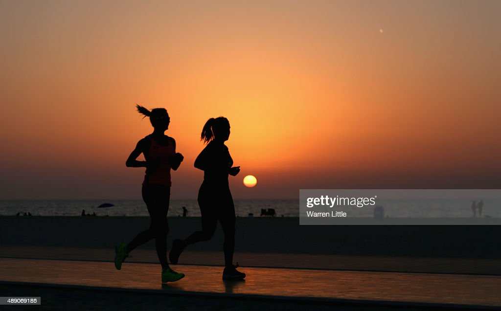 Runners jog along the recently refurbished Kite Beach is pictured on September 14, 2015 in Dubai, United Arab Emirates. The Beach is very popular with Dubai locals, with a variety of water sports and refreshments on offer.