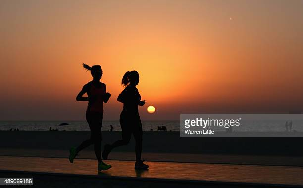 Runners jog along the recently refurbished Kite Beach is pictured on September 14 2015 in Dubai United Arab Emirates The Beach is very popular with...