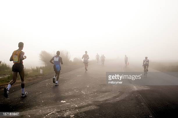 Runners jogging in early morning mist