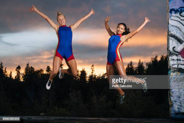 Runners jumping for joy