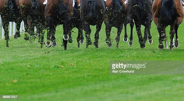 Runners kick up the loose grass cuttings at Chester racecourse on May 05 2010 in Chester England