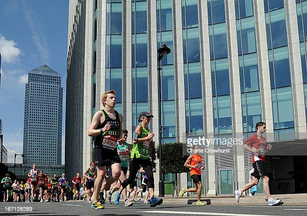 Runners leave Canary Wharf during the Virgin London Marathon 2013 on April 21 2013 in London England