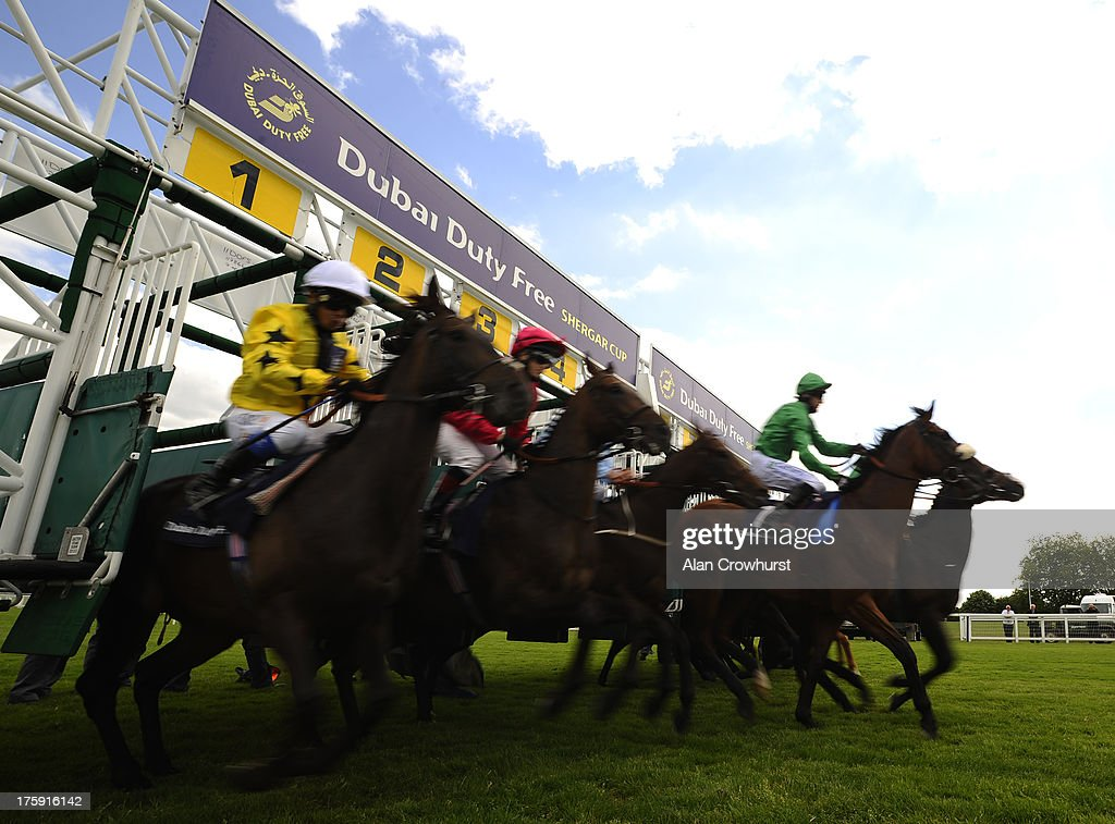 Runners leave the stalls at Ascot racecourse on August 10, 2013 in Ascot, England.