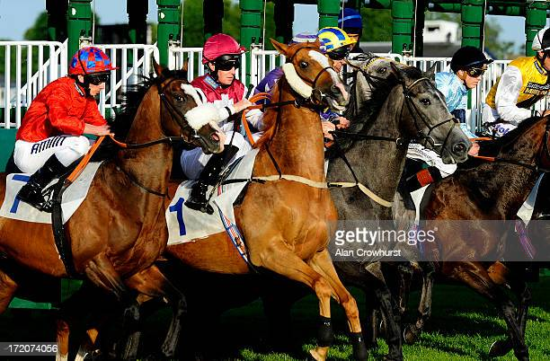 Runners leave the stalls at Windsor racecourse on July 01 2013 in Windsor England