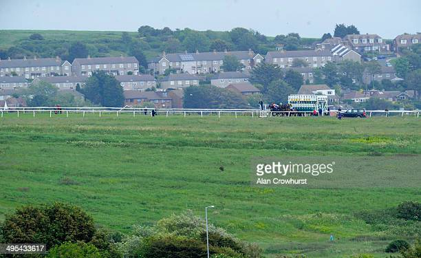 Runners leave the stalls for the one mile and a quarter The Lothbury Investment Management Handicap Stakes at Brighton racecourse on June 03 2014 in...