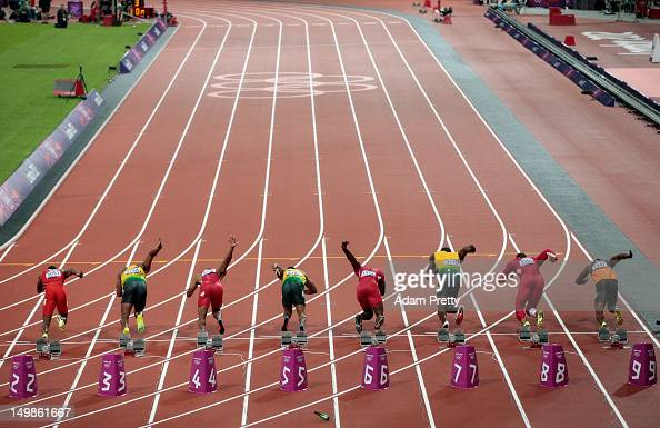 Runners leave the starters block to start the Men's 100m Final on Day 9 of the London 2012 Olympic Games at the Olympic Stadium on August 5 2012 in...