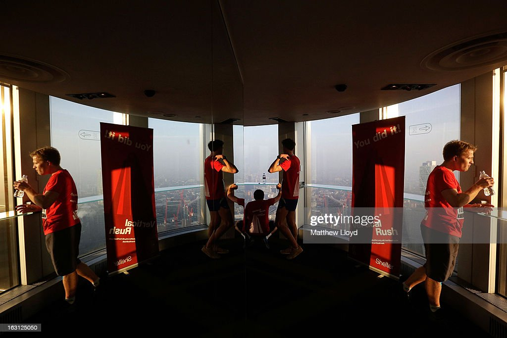 Runners look out the window after reaching the finish of the Vertical Rush event in the Tower 42 skyscraper on March 5, 2013 in London, England. More than a thousand members of the public will climb the 920 steps to raise money for the homelessness charity Shelter.