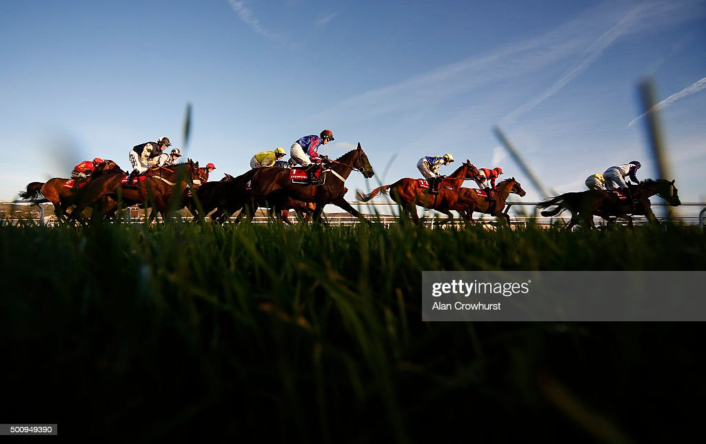 Runners make their way around the top bend in The Citipost handicap Hurdle Race at Cheltenham racecourse on December 11 2015 in Cheltenham England