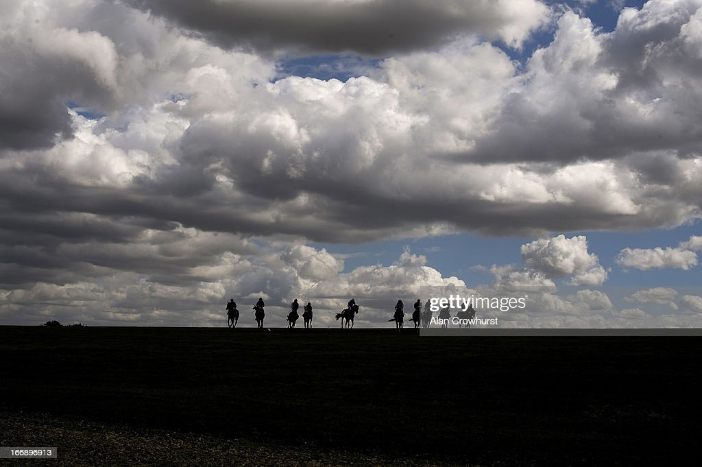 Runners make their way back after pulling up at Newmarket racecourse on April 18, 2013 in Newmarket, England.