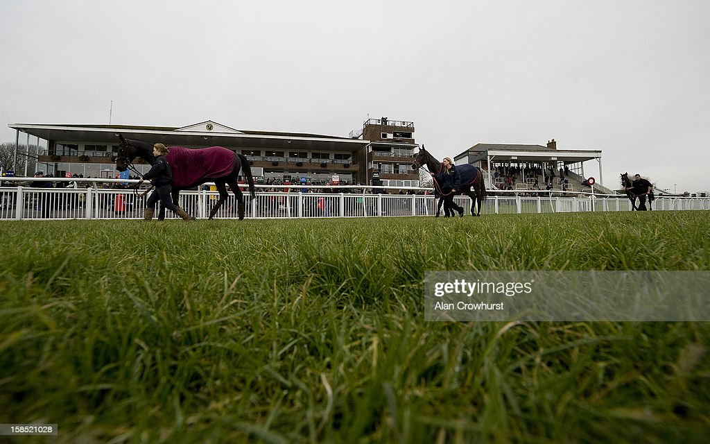 Runners make their way back to the horseboxes after racing during the last meeting to be held after 114 years of racing at Folkestone racecourse on December 18, 2012 in Folkestone, England.