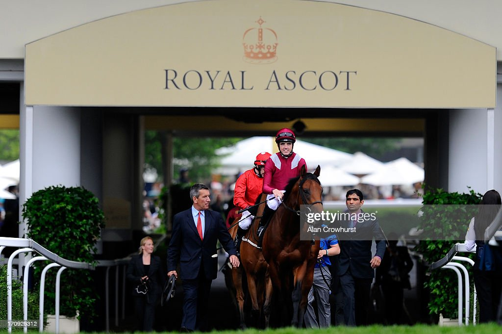 Runners make their way down to post for the Norfolk Stakes on Ladies' Day during day three of Royal Ascot at Ascot Racecourse on June 20, 2013 in Ascot, England.