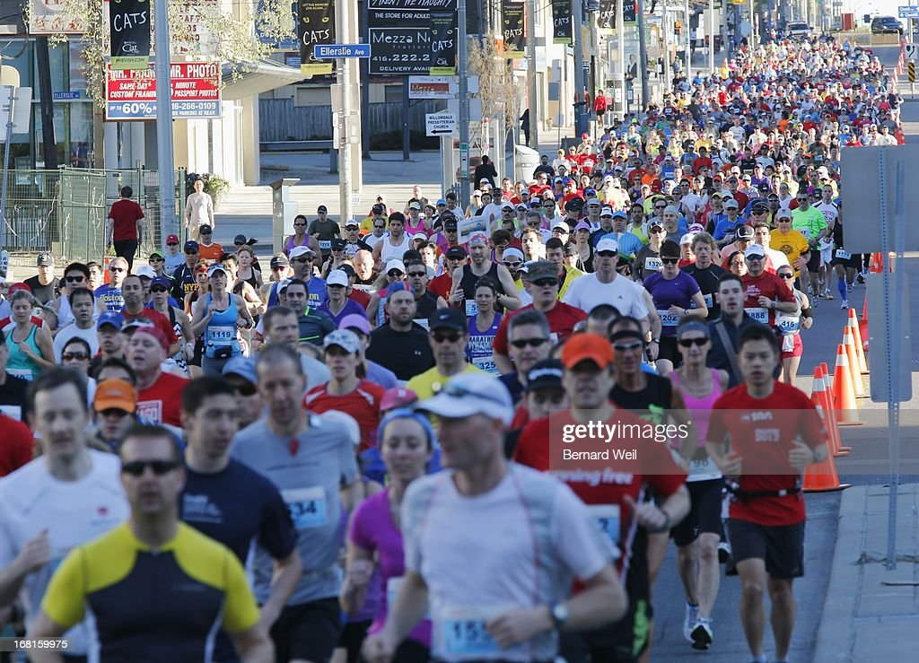 Runners make their way down Yonge St., North York, minutes after the start of the Toronto Marathon.