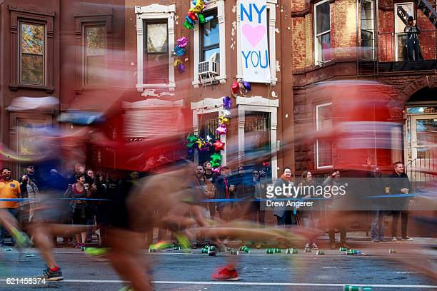 Runners make their way east on Lafayette Avenue during the 2016 TCS New York City Marathon November 6 2016 in the Clinton Hill neighborhood in the...