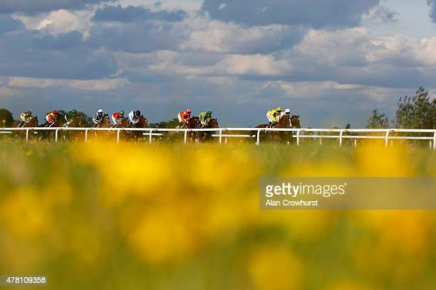 Runners make their way from the one mile start in The Reuben Foundation Maiden Stakes at Windsor racecourse on June 22 2015 in Windsor England