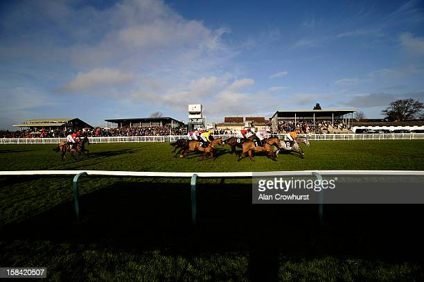 Runners make their way pass the grandstands in The Free Radio Novices' Hurdle Race during the last meeting to be held at Hereford racecourse after...