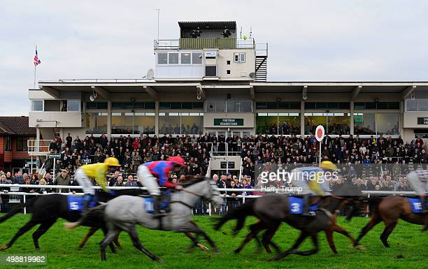 Runners make their way past the grandstand during the Well Done at Cheltenham Ian Popham Handicap Hurdle at Taunton Racecourse on November 26 2015 in...